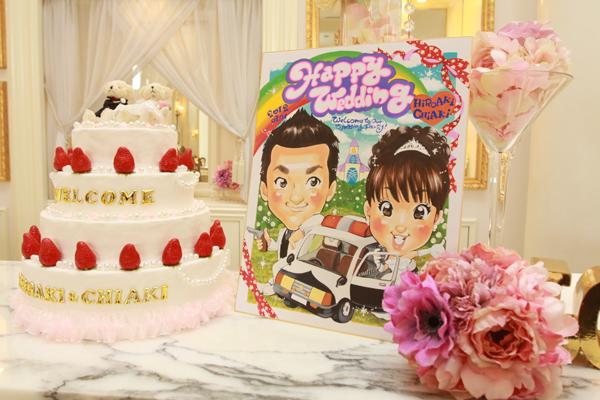 結婚式の為に描いてもらった似顔絵のWelcomeボードとお母さんと作ったWelcomeケーキ