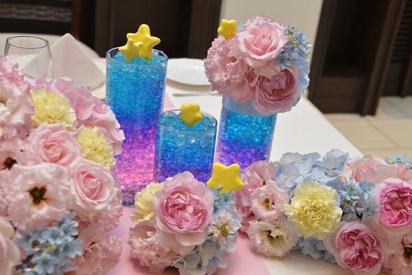 お花のイメージは大好きなキキララ色にたくさんの星を散りばめてもらいとてもかわいい会場になっていました。